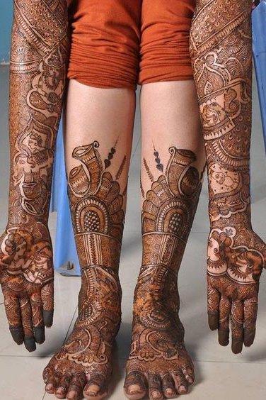 henna tattoo on leg and hands