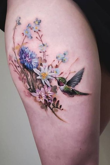birds watercolor tattoo on thigh