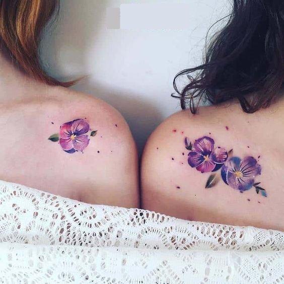 watercolor flower tattoo on shoulder