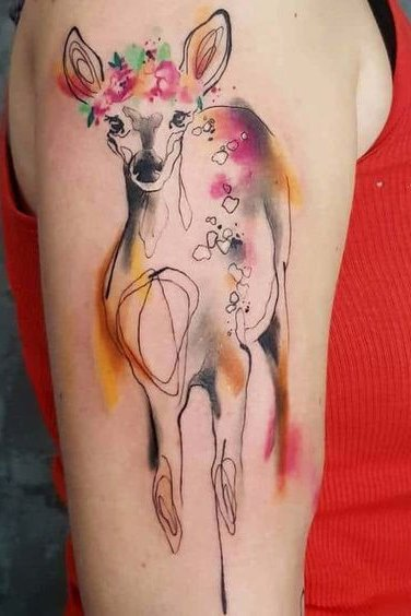 deer watercolor tattoo on upper arm