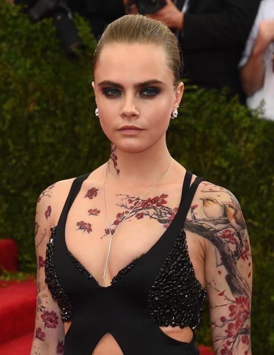 Cara Delevingne tattoos on body