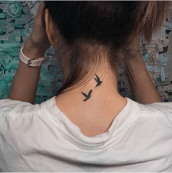 bird tattoos for women on back neck