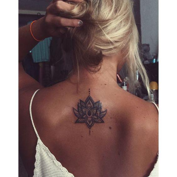 Lotus flower mandala tattoo on back