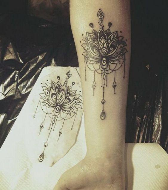 Lotus flower mandala tattoo on wrist