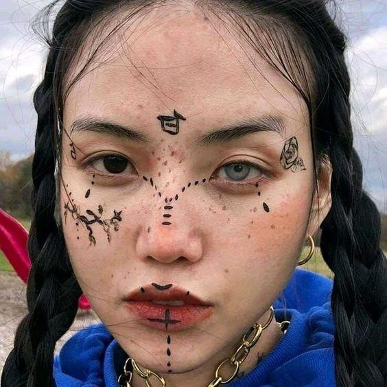 flower face tattoos for women