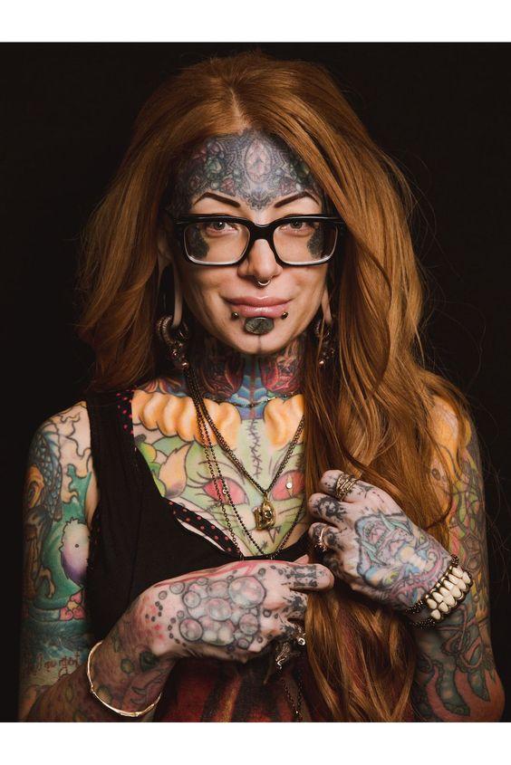 glasses + face tattoos for women