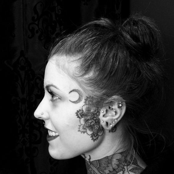moon face tattoos for women