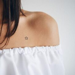 Star tattoos on collar bone