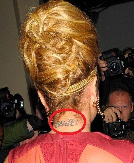 Cheryl Cole back neck tattoo