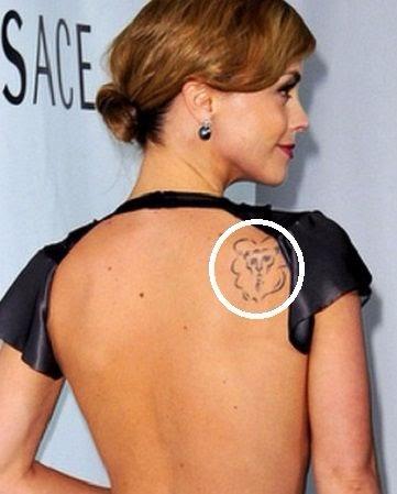Christina Ricci Tattoo on upper back