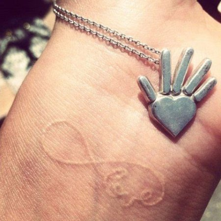 Shay Mitchell Left Wrist Tattoo