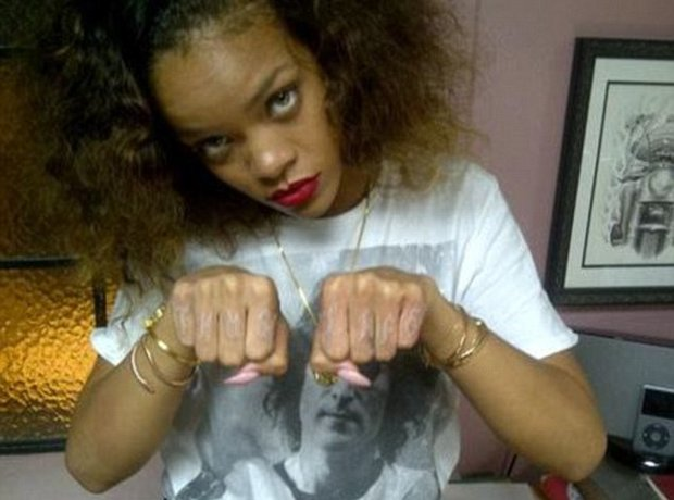 Thug Life on her knuckles