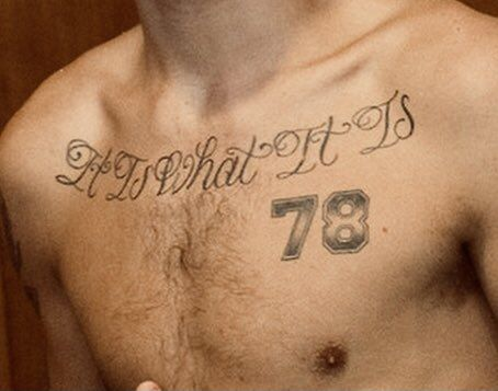'it is what it is' tattoo on chest